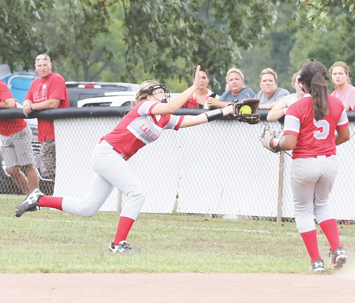 Lady Rebel right fielder Nicole Gibson robs the Fillies of a hit with a running catch.