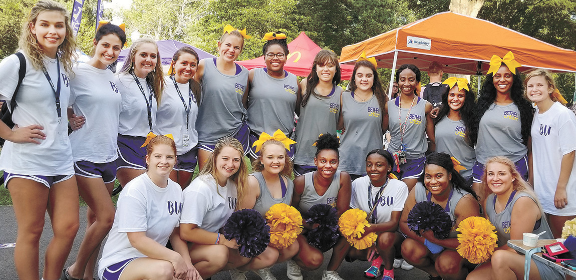 Bethel cheerleaders welcoming new students to participate in student activities.