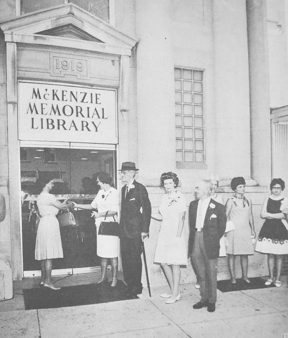 50 YEARS AGO — Mrs. Lloyd Parnell and Mrs. John Morris, co-chairmen of the Library Committee of the McKenzie Business and Professional Women's Club, cut the ribbon to mark the opening of the McKenzie Memorial Library.