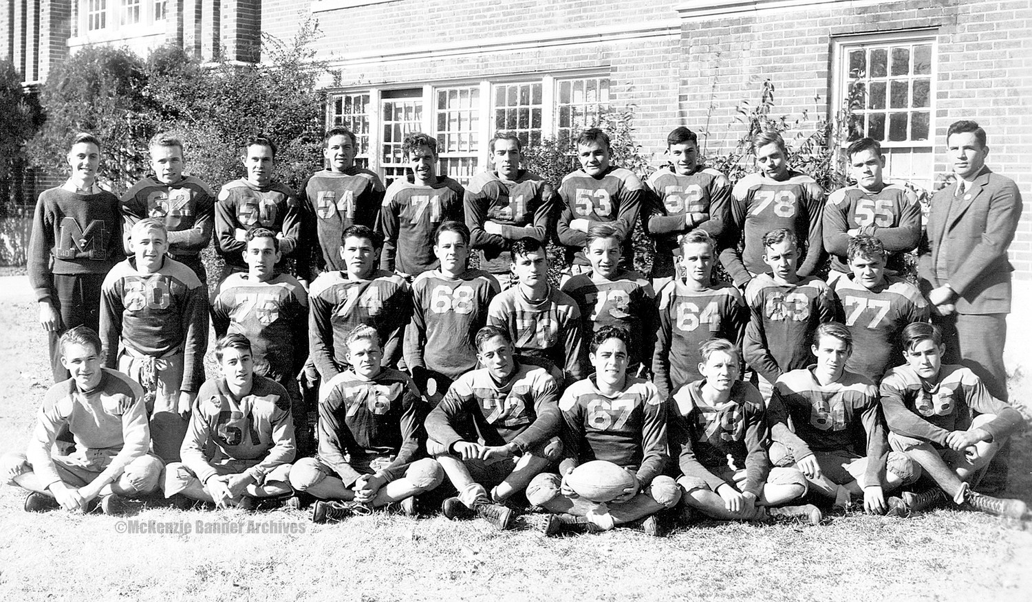 "1940-41 McKenzie High School Football Team - Front Row (L to R): J. B. Johnsonius, Norvell Headden, Doug McCadams, Lucian Nelson, Phillip Williams, R. L. Reynolds, Tommy Connley, Mack Buckley. Second Row (L to R): Frank White Garrett, Wilbur Headden, Howard Smith, Bob Pratt, Otis Dotson, Dan Childress, John Moseley, Paul Carroll, Charlie Simmons. Back Row (L to R): Mgr. Richard Ferguson, Bobby Cozart, Marion Hall Atkinson, Bob Harris, Mike Wilson, Paul Simpson, W.H. ""Bill"" Brush, James Oliver Akers, Charles ""Pappy"" Steele, Bill Brooks, Coach Norman McKenzie."