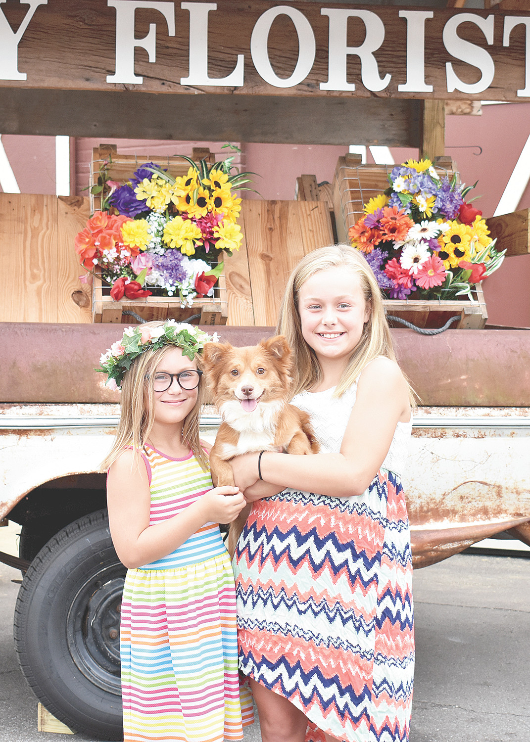 Kynadie (left) and Kortnee Brown brought Missy to the birthday party. The girls, along with sisters Karli and Kassidy, provided homemade dog treats for the event.