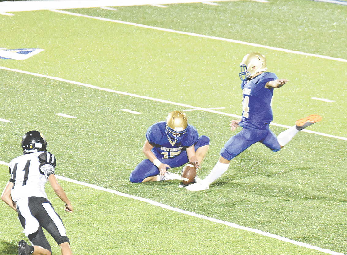 Mustang Cole Edwards kicks a 46-yard field goal as Konnor Pearson holds.