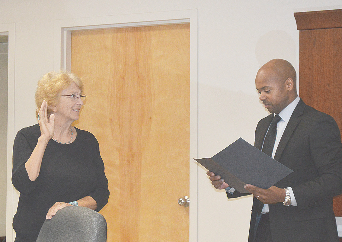 Mrs. Nancy Johnson given Oath of Office by School Director Dexter Williams.