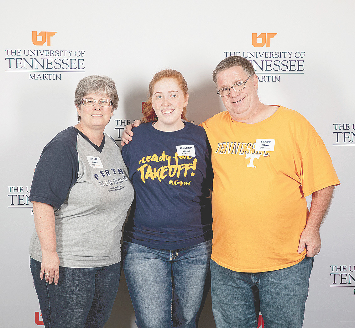 MARTIN (August 29) — Kelsey Hand (center), a graduate of West Carroll High School, attended the University of Tennessee at Martin's annual Legacy Luncheon on Friday for incoming freshmen who are the children and grandchildren of university alumni. Hand is pictured with her parents, Annie and Clint Hand ('88).