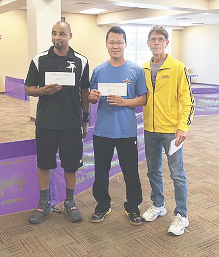 A Division Runner-Up Reggie Wilson (left) and Winner Leidy Handoko with tournament organizer Chris Edlin of the McKenzie Table Tennis Club.