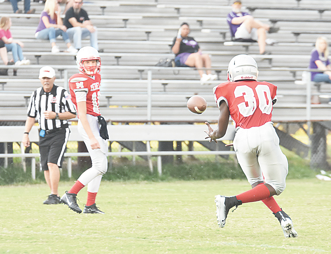 Rebel quarterback Jackson Cassidy throws to Rashad McCreary behind the line of scrimmage for a 24-yard touchdown.