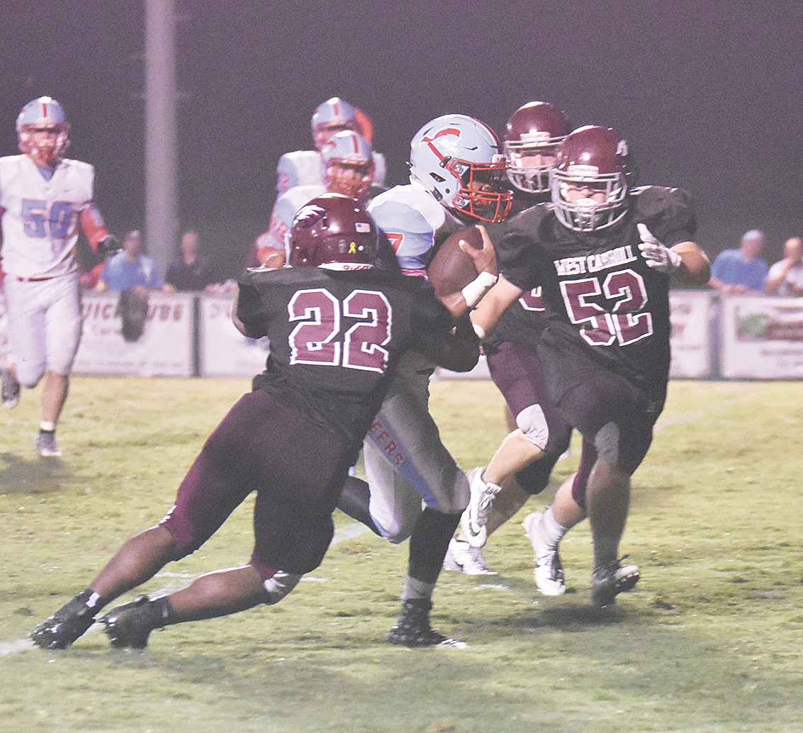 War Eagle P.J. Odom wraps up Pioneer quarterback Payton Lamberson as Blake Davidson (52) moves in for the assist.