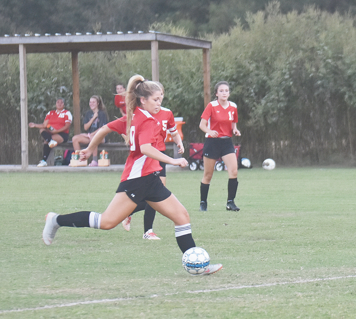 Lady Rebel senior Caleigh Britt strikes on the run for a goal in Thursday's win over Gibson County.