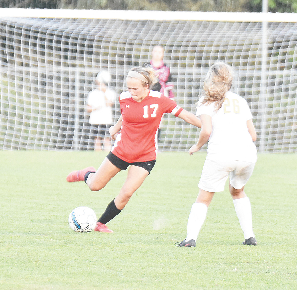 Lady Rebel Maggie Aird clears the ball into Westview territory during Tuesday's tie with the Lady Chargers.