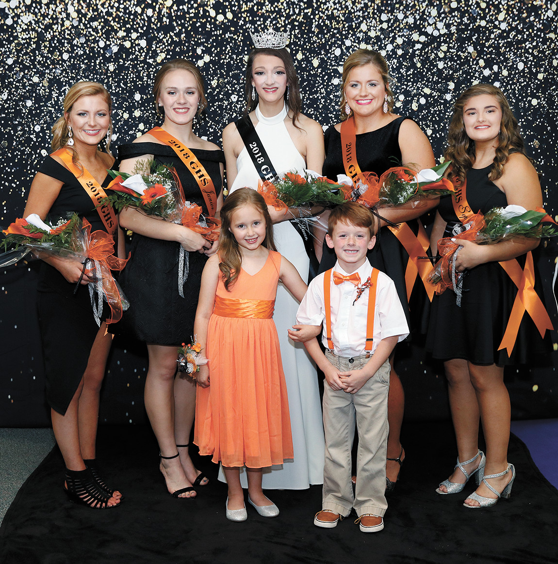 Freshman Maid Darcie Bell, daughter of David and Hollie Bell; Junior Maid Martha Nichols, daughter of Denise Connell; Queen Hannah Whitworth, daughter of Jeff and Roni Whitworth; Senior Maid Bailey Bandy, daughter of Brandon and Nicky Bailey; and Sophomore Maid Lexia Snider, daughter of Anna and David Stout. The flower girl was Emma Pettit, daughter of Eric and Jennifer Pettit and the crown bearer was Gus Lindsey, son of Ryan and Candance Lindsey.