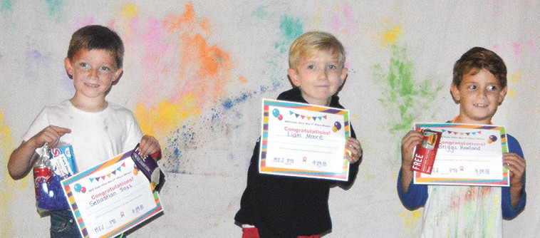 Second grade winners: 3rd place-Briggs Rowland, 1st place-Liam Moore, and 2nd place-Sebastian Sass.