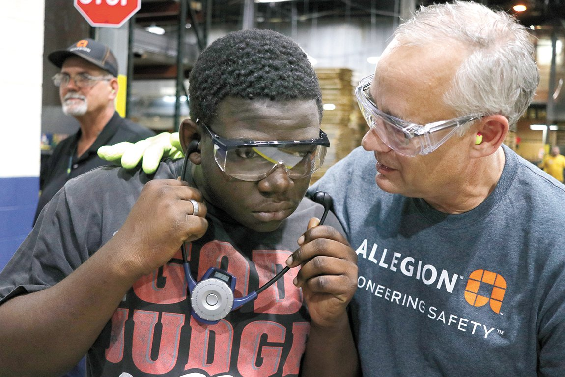 Bob Flaherty, VP of Operations for Allegion, shares a moment with a student from Carroll County Technical School during a tour of the McKenzie, Tennessee manufacturing facility.