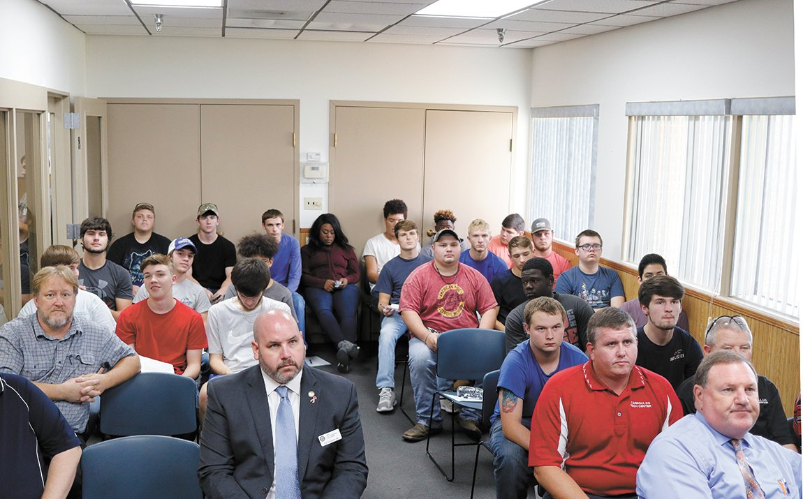 Students from Carroll County Technical School attended a briefing about Allegion and the necessary safety procedures to tour the operations in McKenzie.