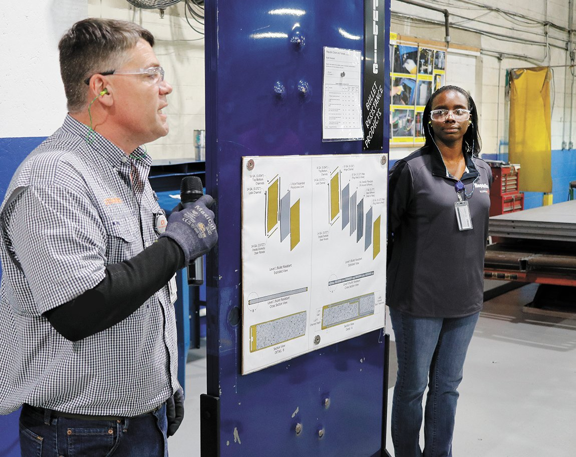 Kevin Jones and Sherry Arnold speak about the bullet-resistant door manufactured at Allegion-McKenzie.
