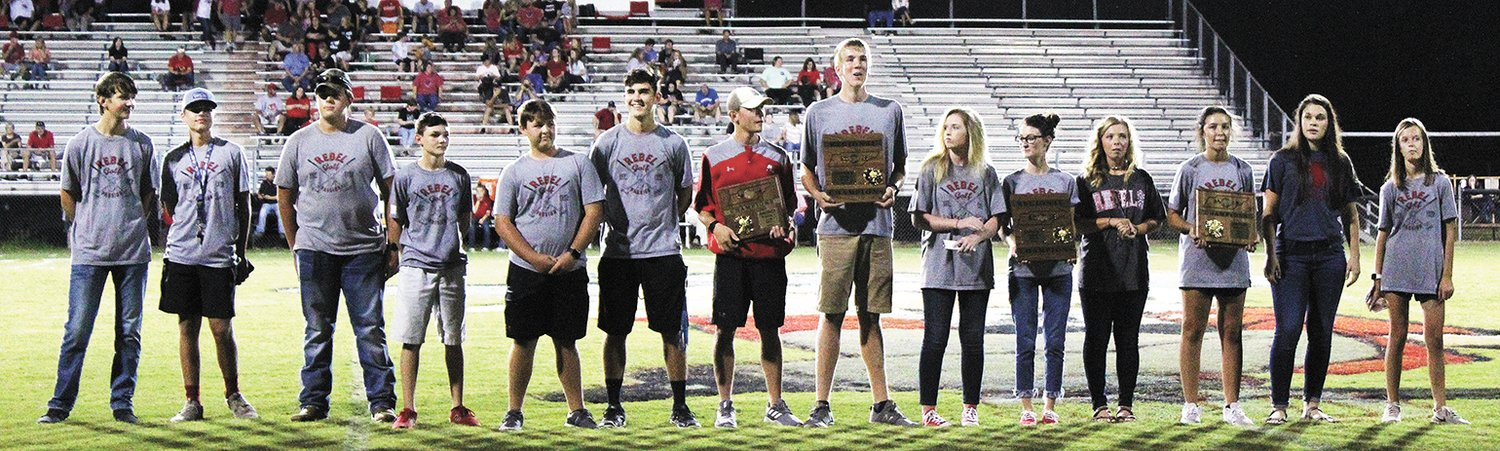 McKenzie golf teams recognized for their district and region titles prior to the game.
