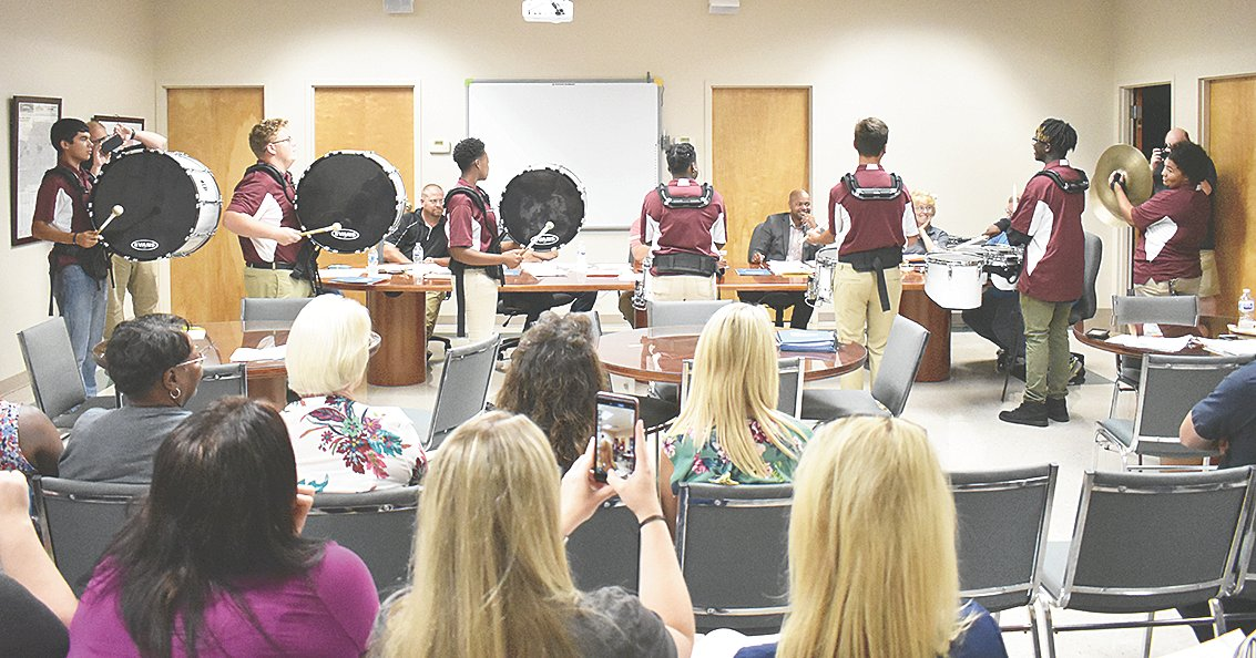 "The Marching War Eagles were recognized in the board's monthly ""Spotlight"" for recent competitive accolades. Pictured performing for the board are percussion members (L to R): Edward Humphreys, Alex Arnold, Jana Clark, Jada Clark, Jacob Mims, Jacob Taylor and Kamryn Hillsman."