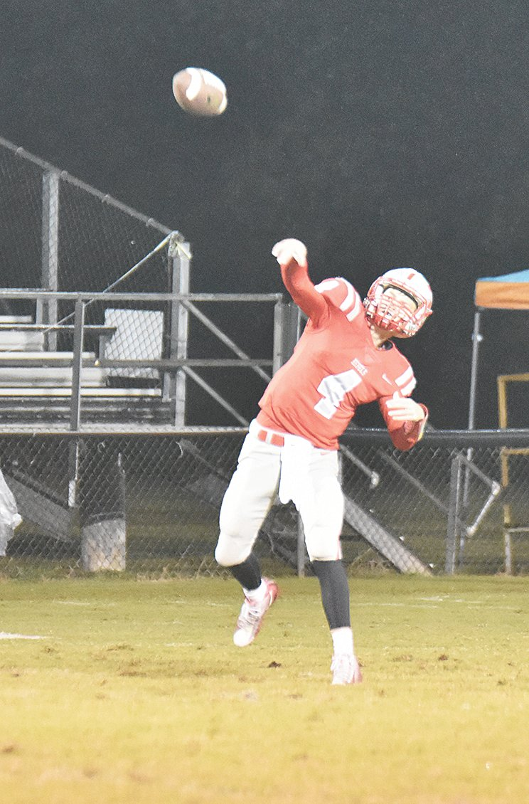 Eli Surber throwing long to Joseph Miller against Union City.