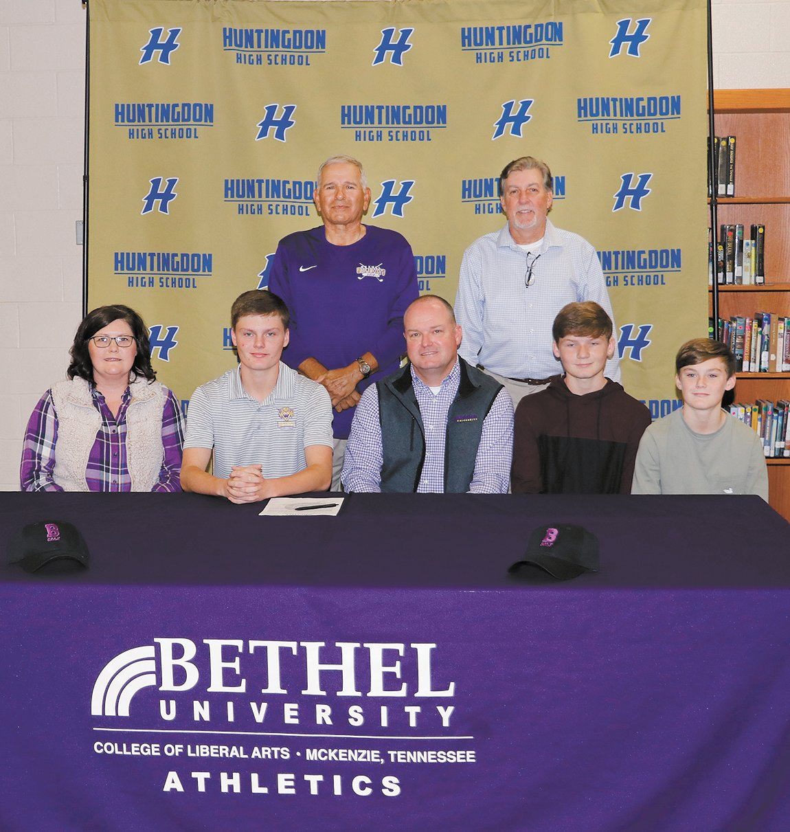 Rickets signs with Bethel: (L – R) Tonya, Ethan, Bud, Nath and Seth Rickets, (back) Bethel Coach Larry Geraldi and Huntingdon Coach Mike Henson.