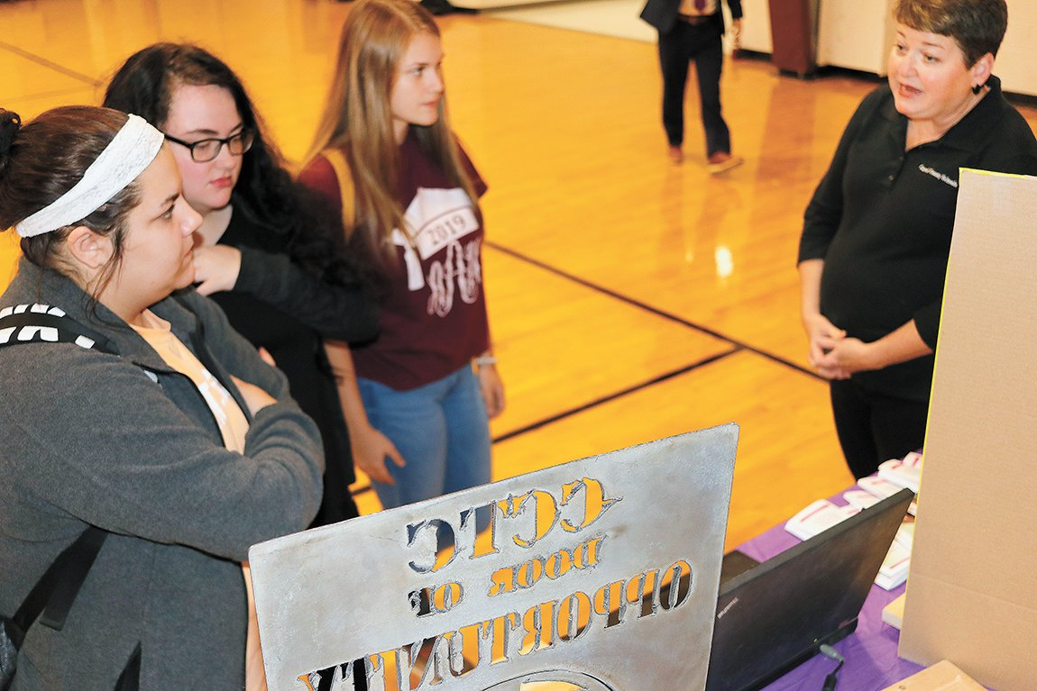 Lisa Norris, a teacher of Criminal Justice at the Carroll County Technical School, speaks to students Maegan Hughes, Autumn Aberle and Allison Jones about the program.