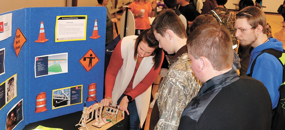 Shawna Smith, an engineer with the Tennessee Department of Transportation, shows a homemade hydraulic assembly to Jack Lawrence, Jordan Roberts,, River Hays, Davin Hivner, and Terry Carroll.