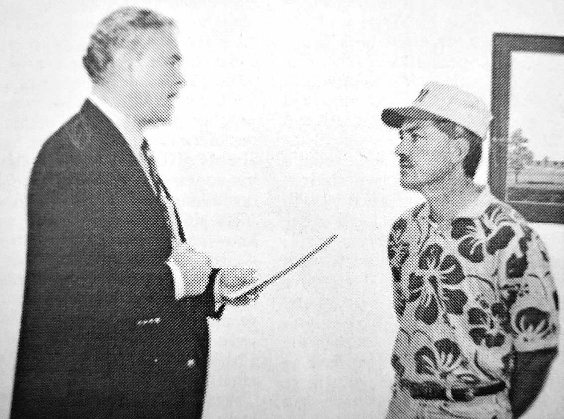 20 YEARS AGO — McKenzie Special School District Superintendent Dr. Bentley Rawdon (left) administers the oath of office to newly-appointed board member Clay Kirk.