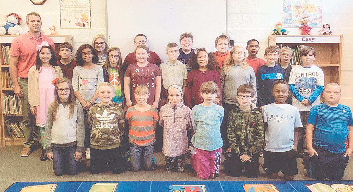 Coach Wall's fourth grade class reached its reading goal of 1,000 Accelerated Reader points in October. The class maintained an average of 90.7 percent correct in comprehension while achieving the goal. Congratulations to the class and keep up the hard work!