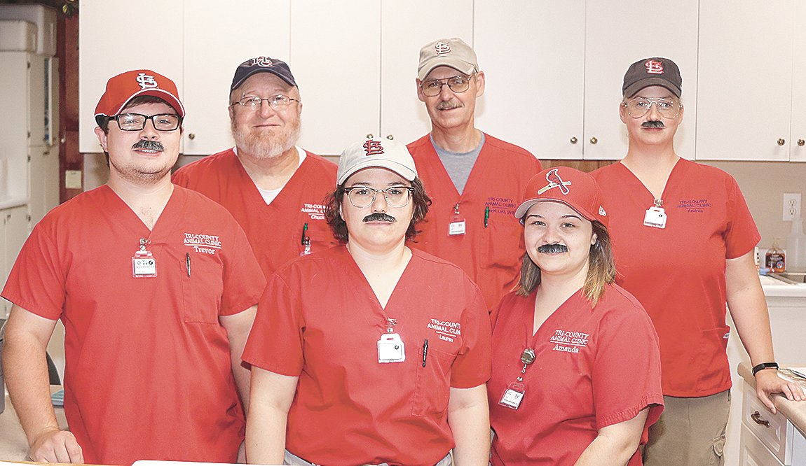 On Halloween, Tri-County Animal Clinic workers all dressed up as Dr. David Lott. Pictured are (L to R): Front Row — Trevor Foster, Lauren Barker and Amanda Smith; Back Row — Chuck Adams, Dr. Lott and Andrea Maddox.