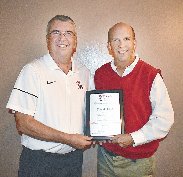 MHS golf Coach Larry Joe Smith (left) presents a plaque to Tim McBride in appreciation of his contributions to the program.