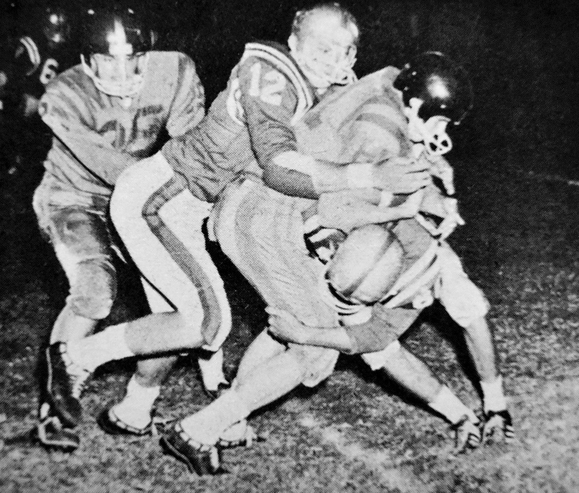 50 YEARS AGO — Rebel defenders swarm a Mustang ball-carrier in Huntingdon's 35-14 win over McKenzie.