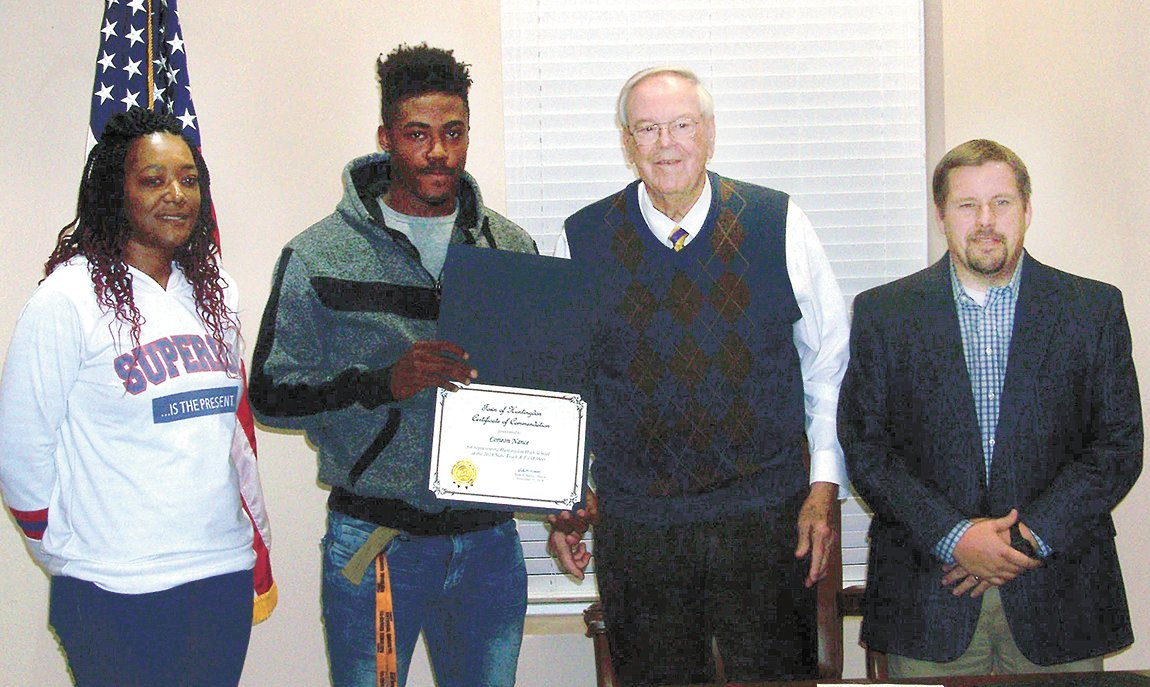 Corieon Nance receives a commendation for participating in the Tennessee Cross Country Championships. From L to R: Michelle Pearson, Corieon Nance, Mayor Dale Kelley, and Coach Clint Ezell.