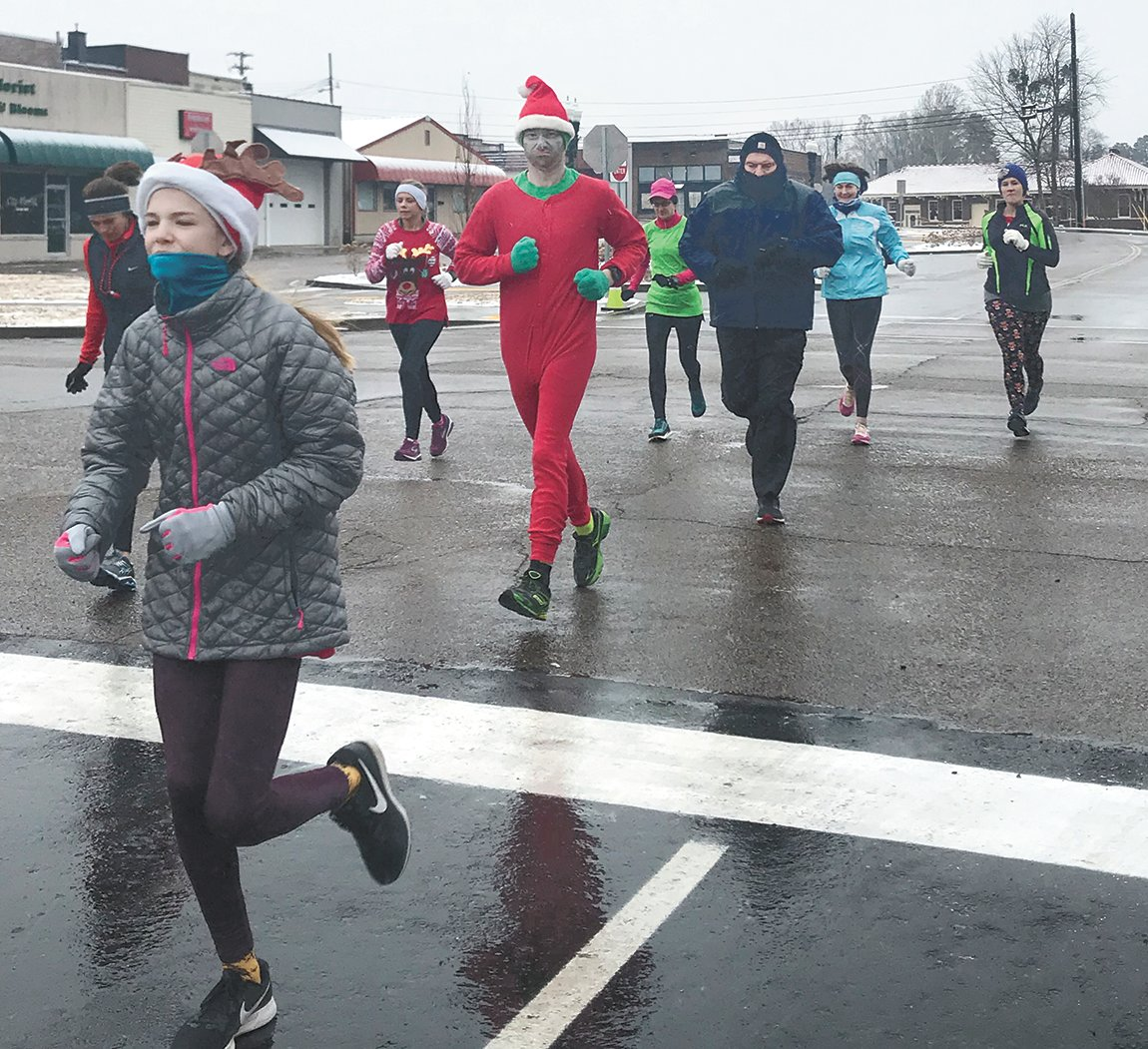 Despite wet and dreary conditions, runners for the Catch Me Under the Mistletoe 5K bundled up and gave it their best.