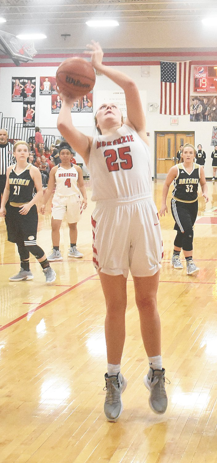 Lady Rebel Anna Callahan gets isolation in the paint for an uncontested layup. Callahan scored six for McKenzie.