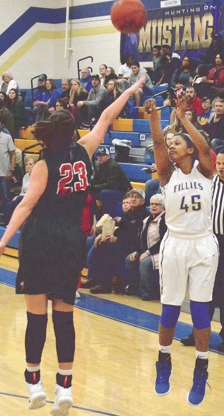 Tyasia Reed hits one of her four three-pointers. Reed led all scorers with 21 points against Obion Central.