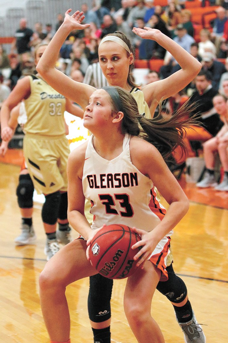 Gleason's Kenady Atkins moves in for a basket.