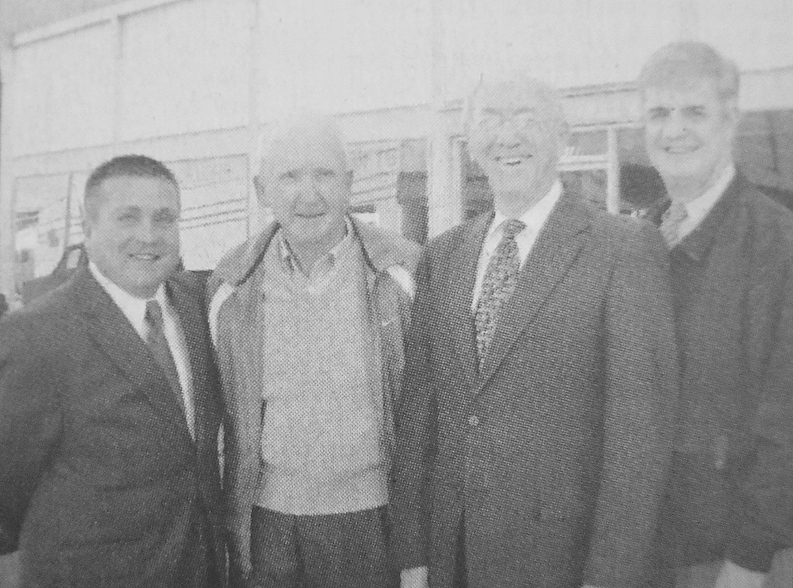 10 YEARS AGO — Bethel College acquired the historic Wrinkle building in downtown McKenzie. Pictured are (L to R): Mike Parker, Bethel director of capital funding; retired businessman Bailey Wrinkle; Bob Prosser, Bethel College president; and Walter Butler, Bethel director of business affairs.