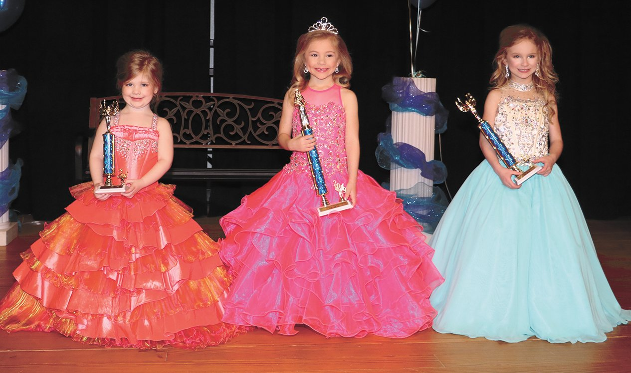 Miss Petite Ages 4-5 (L to R) Second Maid Kinslee Elizabeth Robertson, daughter of Aaron and Delaine Robertson; Queen Bennett Ramsey, daughter of Matt and Jacquelyn Ramsey; First Maid Ella-Cate Massey, daughter of Taylor and Megan Massey. The event was hosted by the Huntingdon Marching Mustangs.