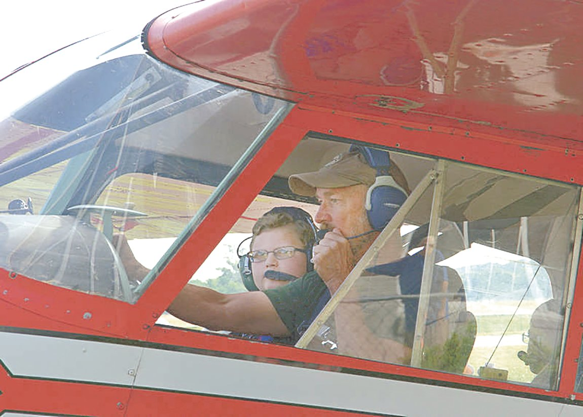 Experienced pilots will fly kids for free this Saturday at Carroll County Airport.