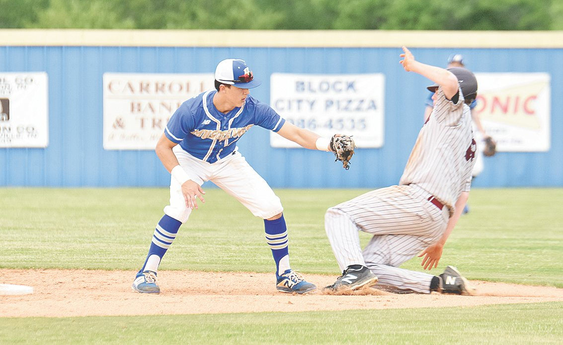 Mustang shortstop Hunter Ensley tags a War Eagle runner attempting to advance to second base.