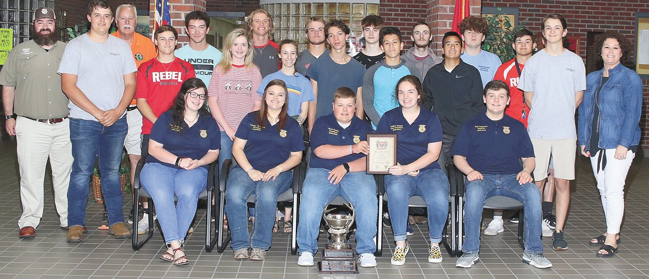 Matt Simcox of Hunters for the Hungry and Lance Rider of the Tennessee Wildlife Federation presented FFA students with the silver cup for their volunteer service.