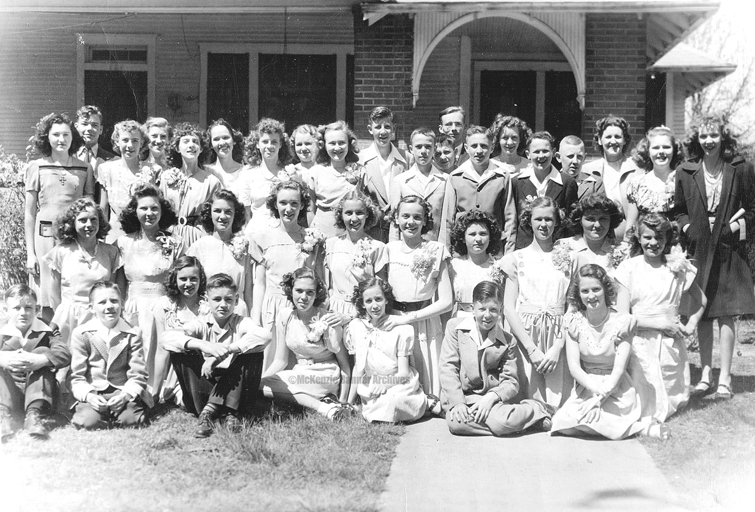 McKenzie Eighth Grade Graduation, 1948, at Miss Ophie Everett's home on Magnolia Ave. First Row (L to R): Kenneth Townsend, Billy Hall, Ann Sneed, Gaylon Hickman, Joyce Hill, Marty Carter Highfield, B. W. Hickman, and Martha Wray. Second Row: Arlene Washburn, Maxine Sneed, Joan Montgomery, Mary Ann Young, Betty Carroll, Mable Claire James, Betty Williams, Sarah Crawford, Lois Williams, and Patty Edwards. Third Row: Rachel Miller, Anita Clark, Gay Ellis, Blanche McDonald, Sara Ann Kirksey, Jimmy Coleman, Frank Galloway, John Ward, Jimmy Montgomery, Phyllis Bunn, and Peggy Butler. Fourth Row: Billy Pinson, Joyce Smith, Violet McElhiney, Helen Pate, J. T. Matheny, Jimmy Pate, Vernette Bannister, and Miss Ophie Everett. Photo submitted by Vernette Hacker.