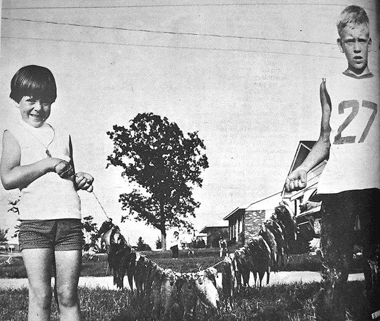 50 YEARS AGO — Jan and Frank Ridley display a string of 43 blue gill fish that Frank helped catch at Carroll Lake.