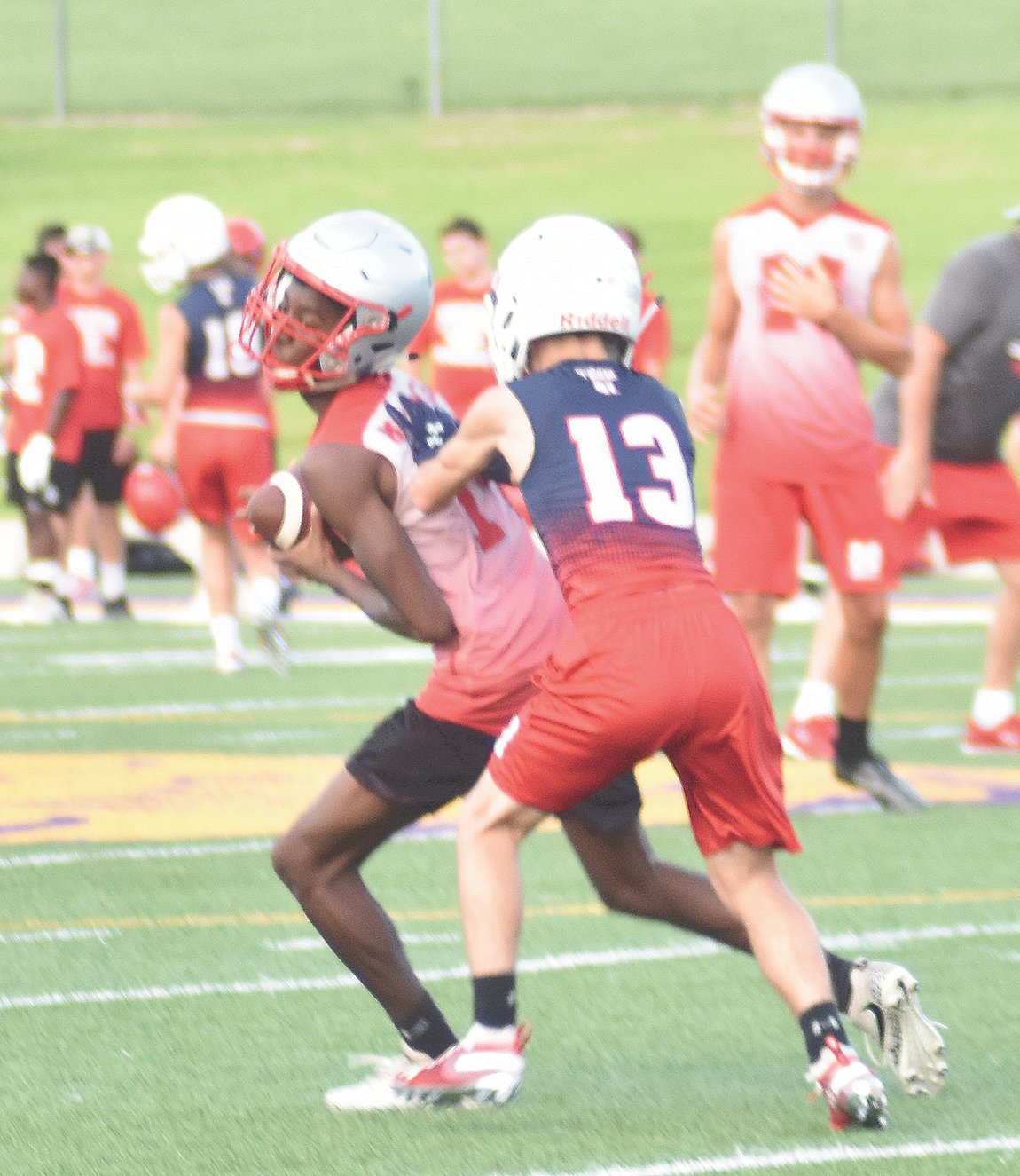Jordan Gilbert grabs a pass against a Henry County defender during last Thursday's competition.