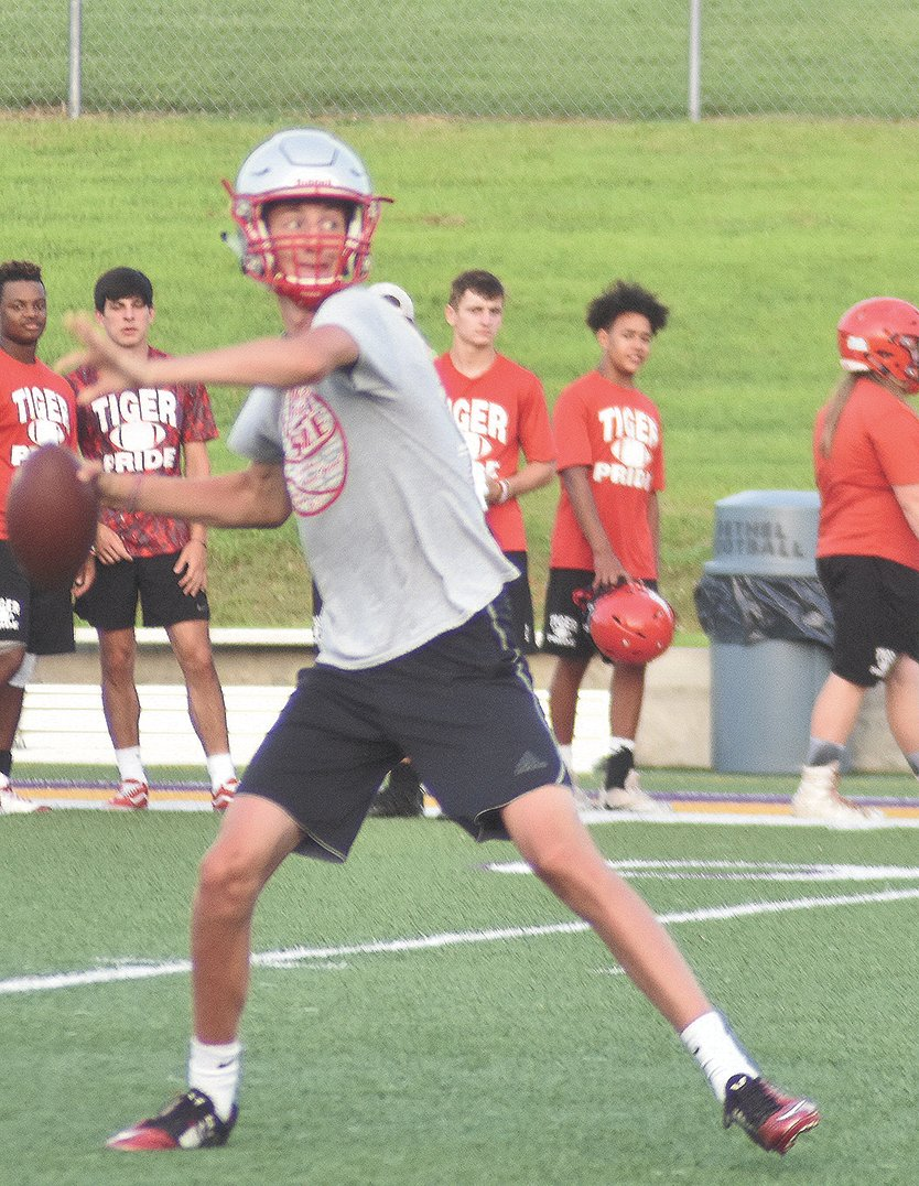 Senior quarterback Evan Jarrett drops back to throw in during 7 on 7 competition against Lexington last week.