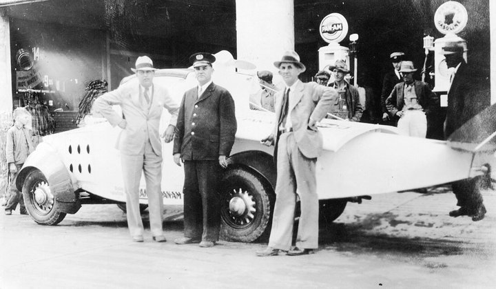 Hall Bryant, Ivery Smith (Chief of Police), and Mr. Parks, owner of service station at Tri-County Motor Co., late 1920s. Ivery Smith was the father of Dr. T. Howard Smith.