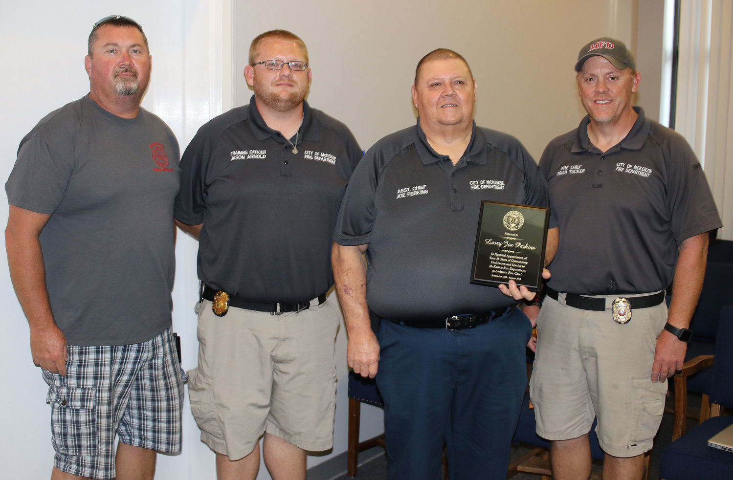 Congratulating Joe Perkins on his 31 years of service to McKenzie Fire Department are Assistant Chief Roger Christian, full-time firefighter Jason Arnold, Retiring Assistant Chief Joe Perkins, and Chief Brian Tucker.