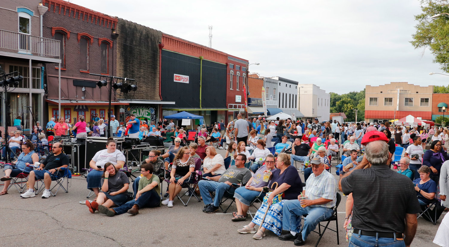 A large gathering of people enjoyed the evening entertainment along Broadway Street.