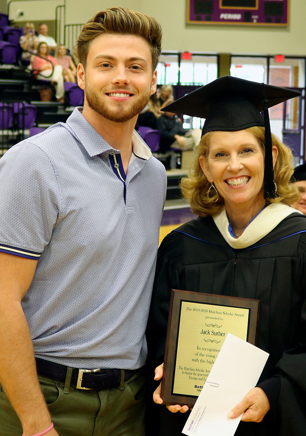 Jack Surber, a senior at Bethel University and Cindy Mallard, Vice President of the College of Arts and Sciences.