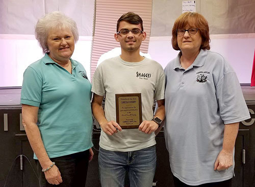 Christian Nunnery was presented the Carroll Arts Friend of the Arts Award by Carroll Arts President Glynda Rich (left) and Treasurer Denise Sam (right).