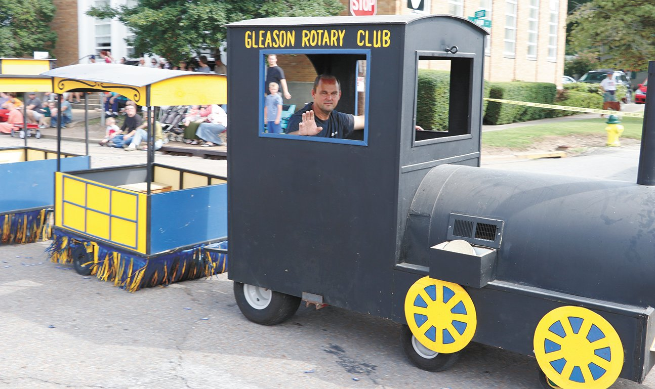 David Esch, president of Gleason Rotary, drive the club's train.