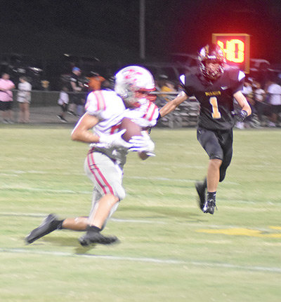 Logan Lyles get yards after a catch.